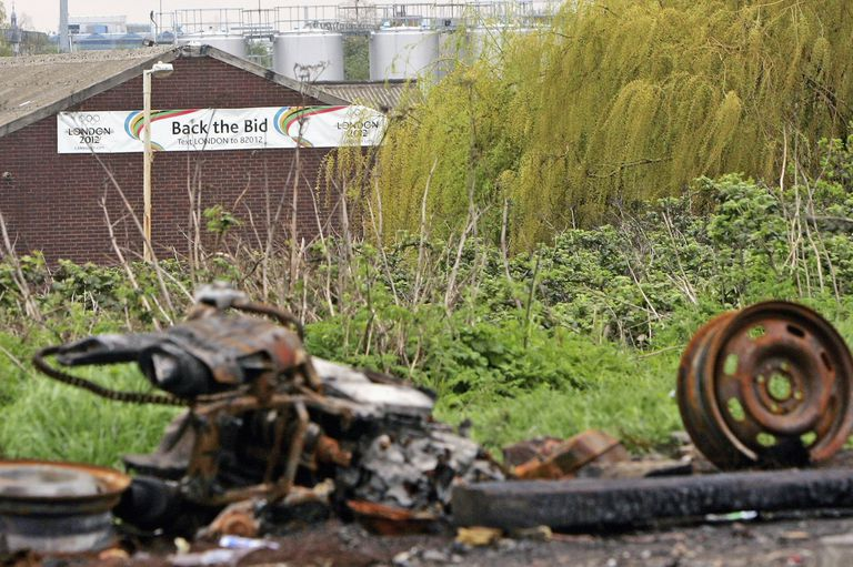 "A banner on a derelict building announces ""Back the Bid"" for Pudding Mill Lane to be the reclaimed site of the London Summer Olympic games in 2012"