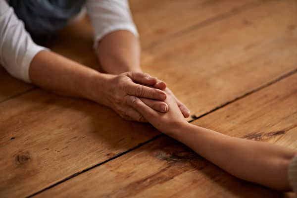 Holding hands with a grieving friend