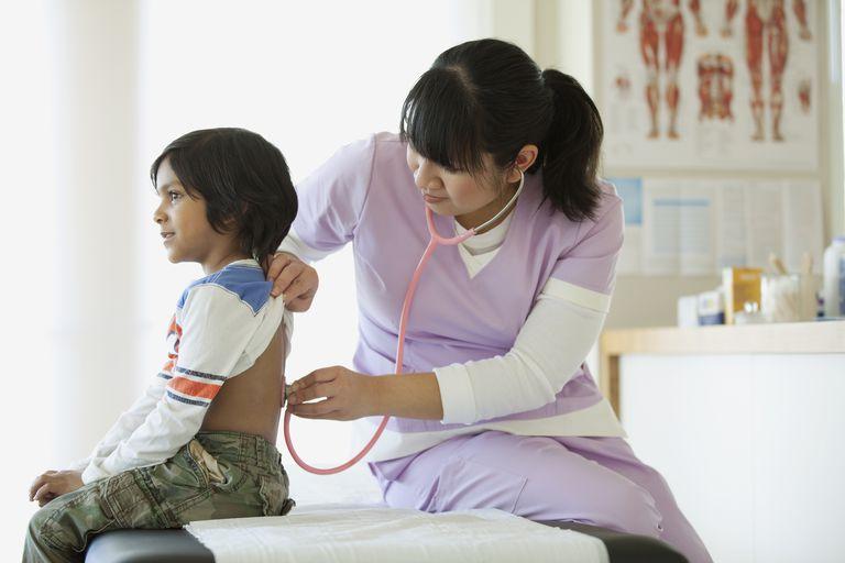 Nurse with a child patient