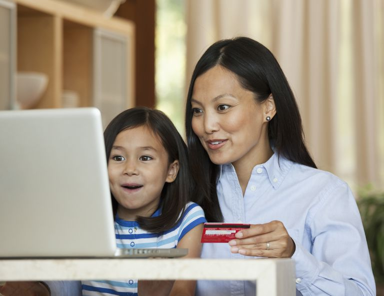 mother and daughter shop online together.