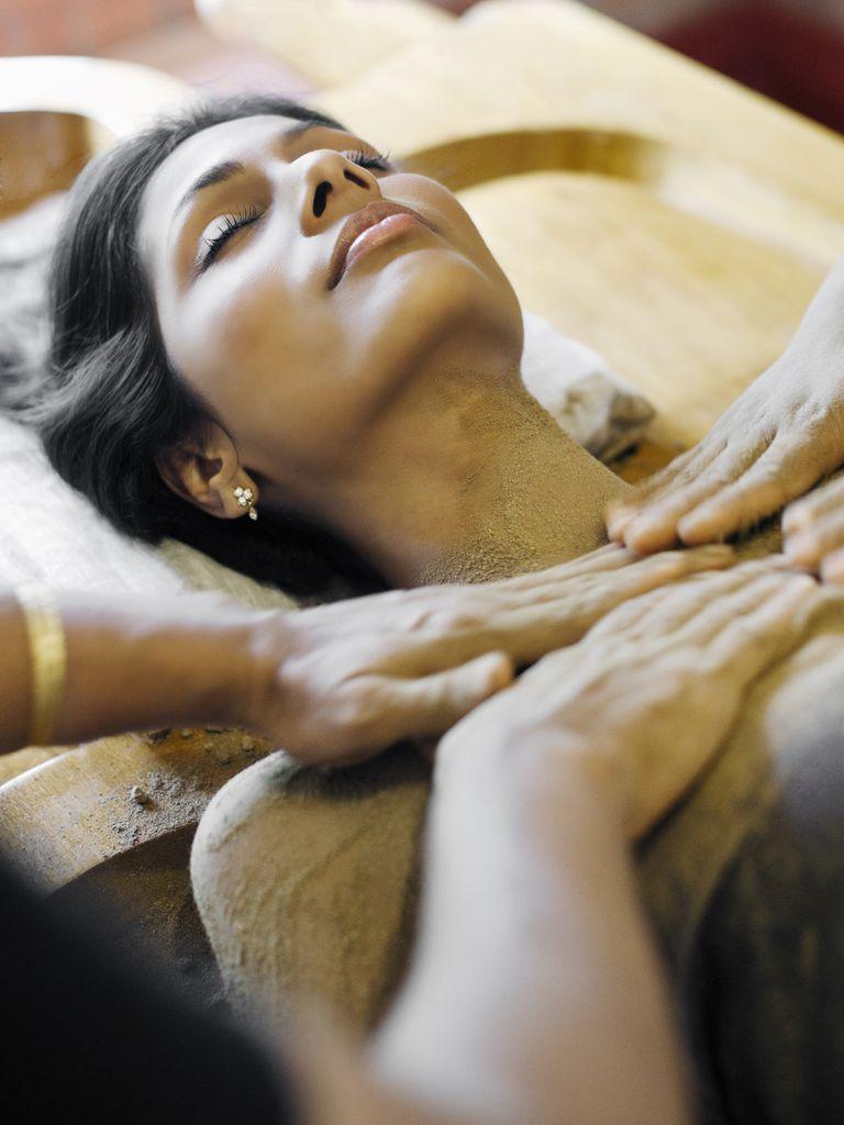 Woman Receiving Udwarthanam, Ayurvedic Treatment