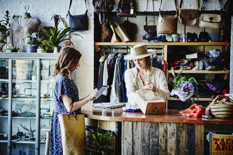 Women at retails store cash wrap