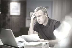 Man looking at laptop with worried look on his face
