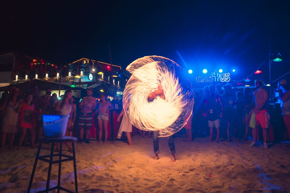 Fire Performer Spinning Fire Ropes at full Moon Party, Koh Pangan