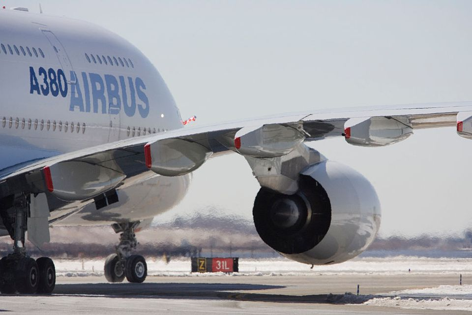 The arrival of the Airbus A380, Airbus's new super-jumbo jet, on its inaugural route-proving flight to JFK International Airport in New York.