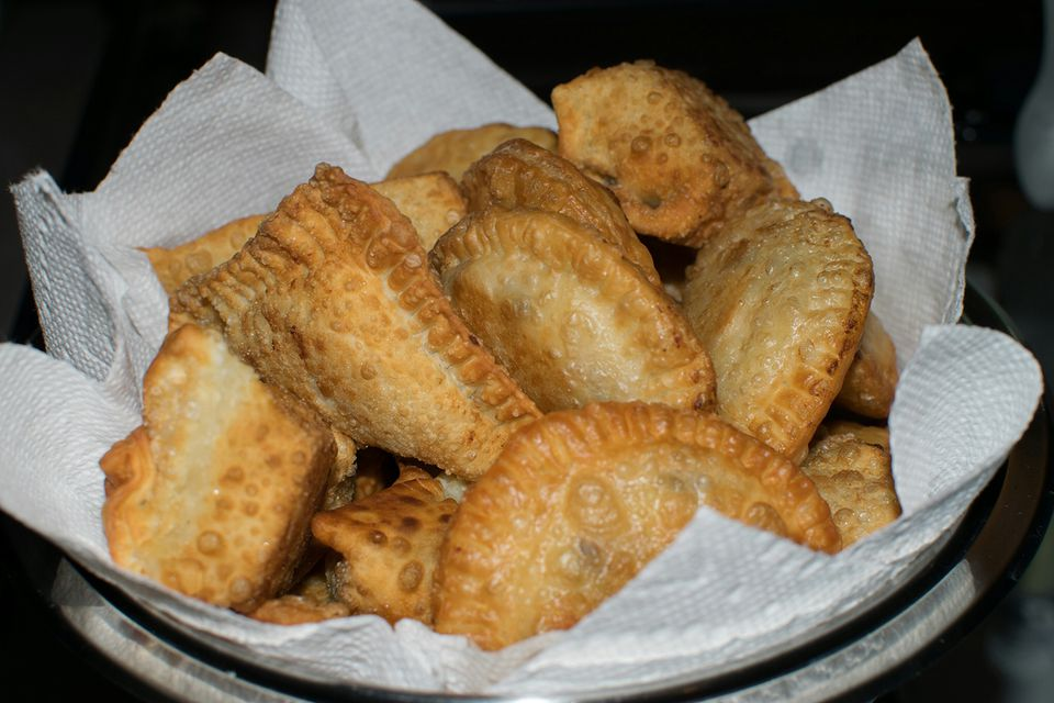 Close-Up Of Fresh Empanada On Tissue Paper In Bowl