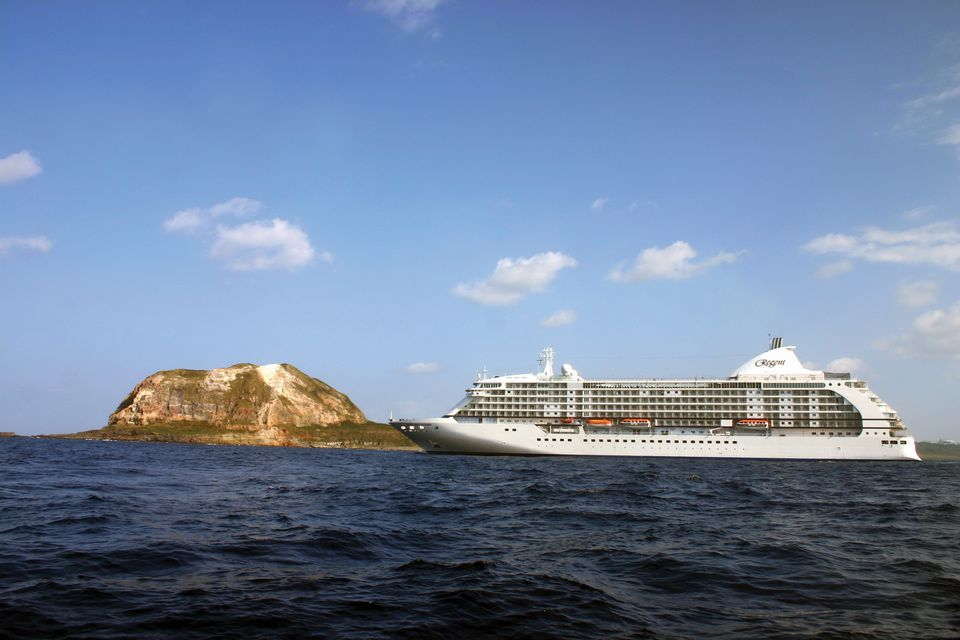 Regent Seven Seas Voyager cruise ship off the shores of Iwo Jima, Japan