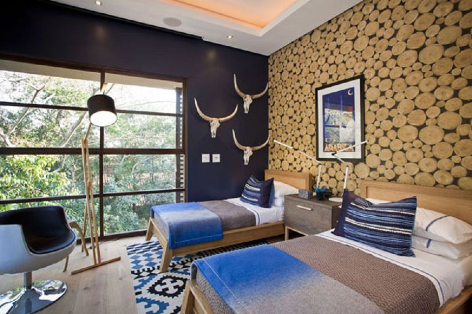 Modern rustic bedroom with dark blue walls.