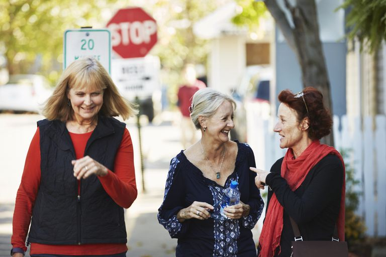 senior women walking and talking