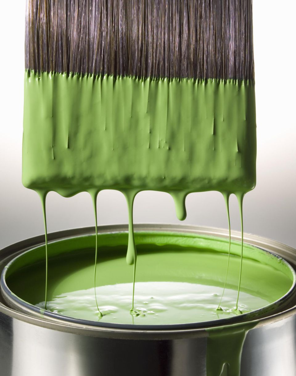 Green Low VOC paint dripping off of big paint brush
