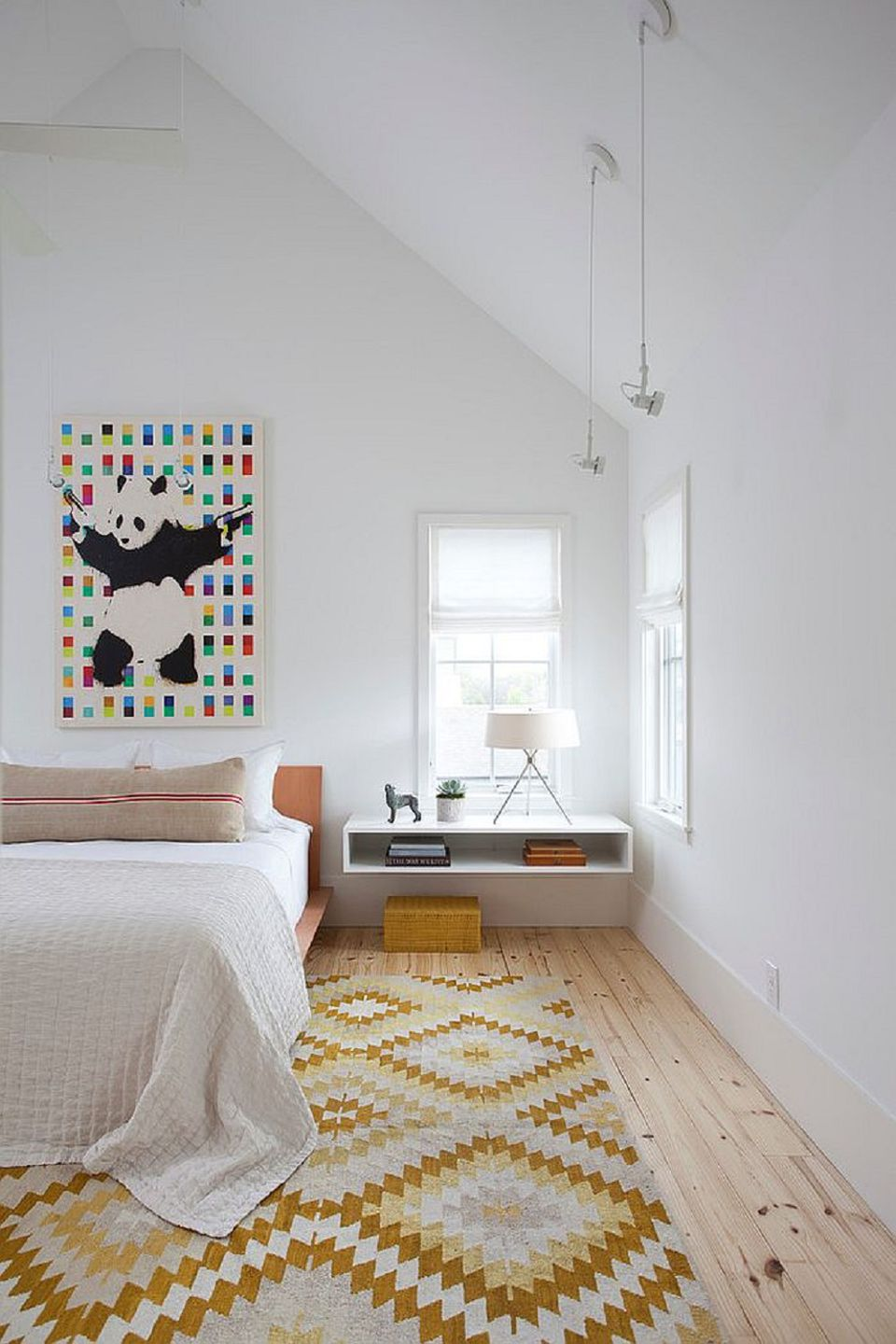 Scandi bedroom with colorful artwork