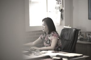 Woman working alone in home office