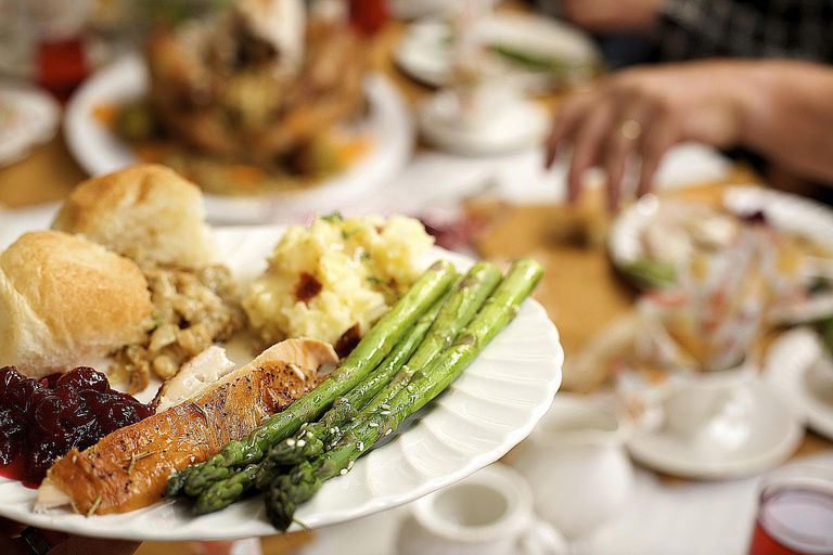 A full plate at Thanksgiving dinner symbolizes American abundance, belonging, and identity.