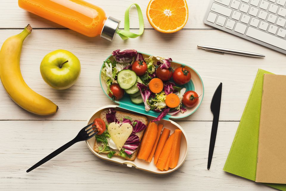 Healthy dinner from lunch box at office working table