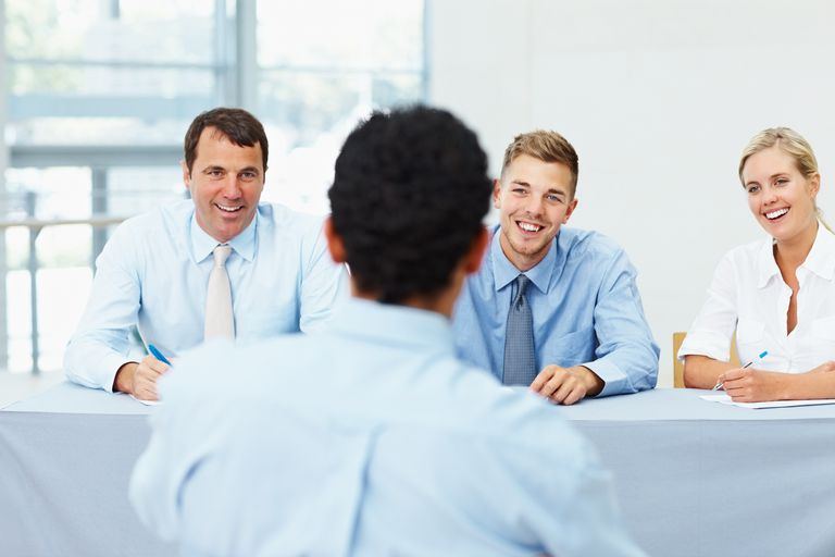 Employee being interviewed by a panel of interviewers