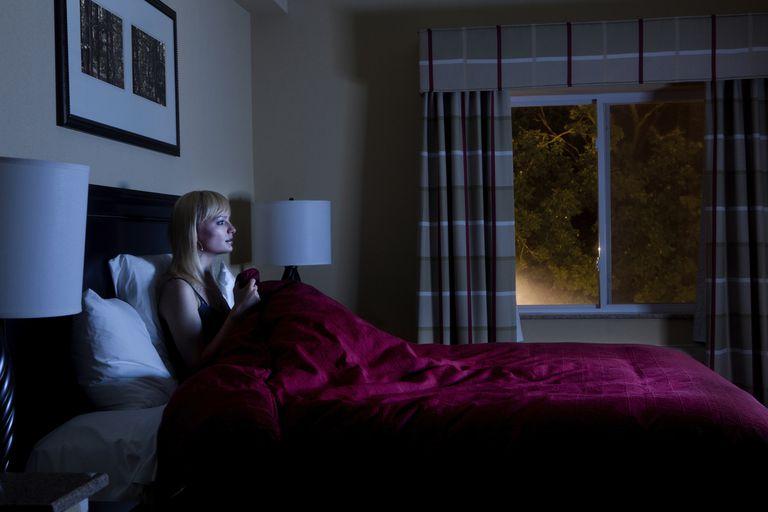 Woman watching TV at night