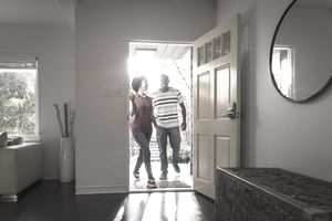 Couple walking into new home