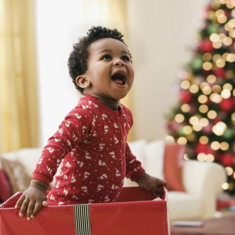 Toddler in Christmas gift box