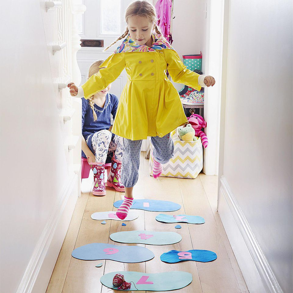 A picture of a child playing indoor hopscotch