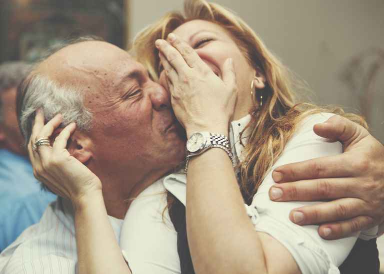mature couple kissing and laughing