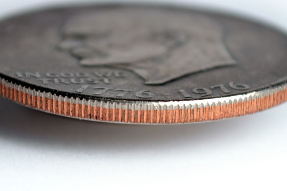The edge of an Eisenhower dollar showing the clad layers of the coin