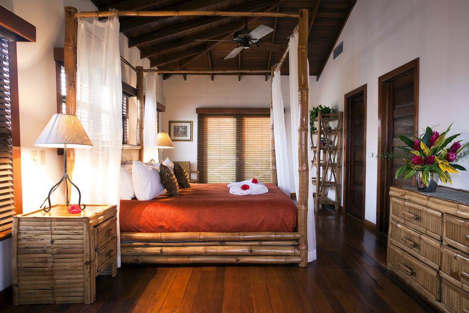 Central America, Belize, Ambergris Caye, San Pedro, a bedroom in the Casa Azul (Beachfront) villa at the Victoria House hotel