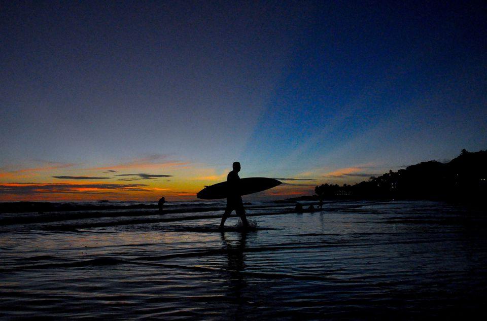 El Salvador beach with surfer