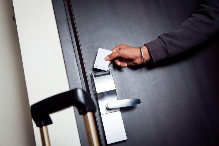 Man opening hotel room door