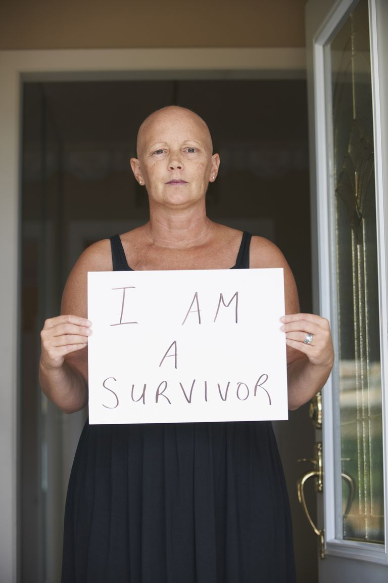 cancer survivor with sign
