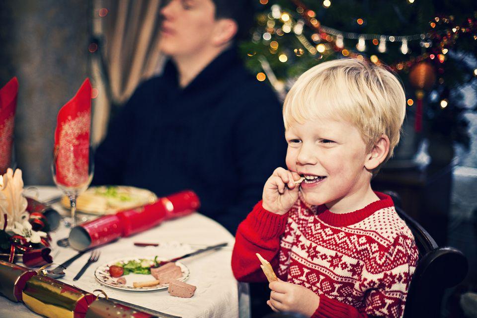 Child eating Christmas dinner.
