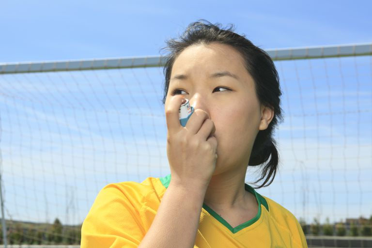 Soccer player using inhaler