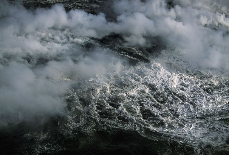 Steam rising off of ocean from lava flow