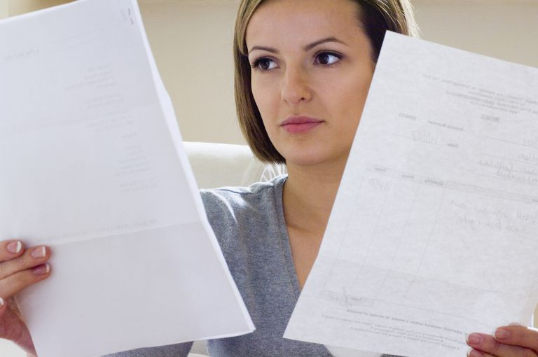 Woman looking at paperwork