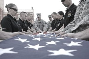 soldiers folding a flag