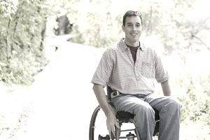 Young man in a wheelchair.