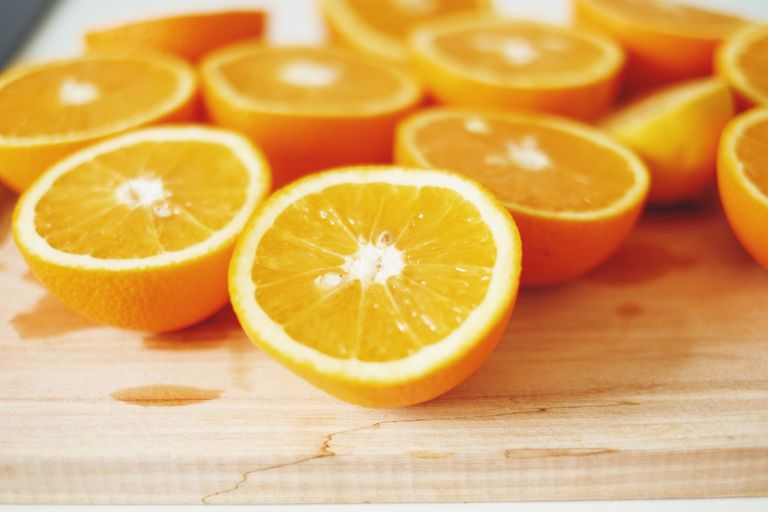 Close-Up Of Fresh Sliced Oranges On Cutting Board
