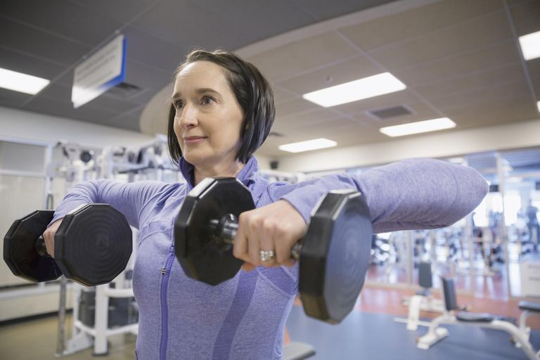 Close up of woman weight lifting at gym