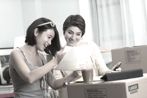 Two young women looking at paperwork for new apartment