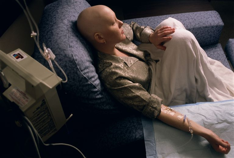 Young woman receiving chemotherapy, elevated view