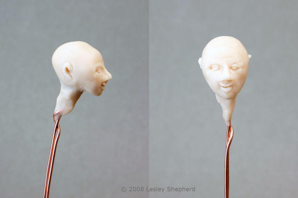 Adding a neck to a miniature doll's head sculpture