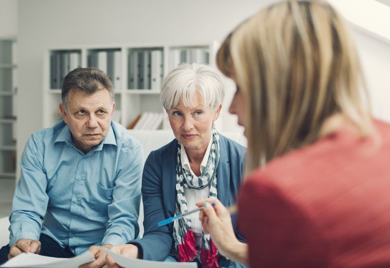 Mature Couple Meeting with lawyer.
