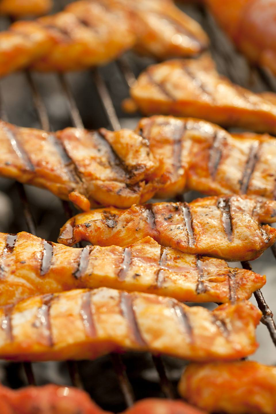 Grilled meat, marinated turkey breast on a grill