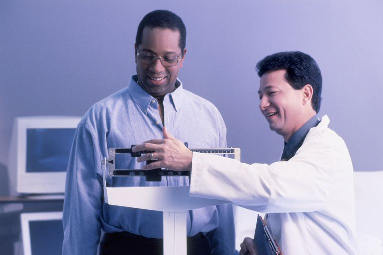 researcher weighing man