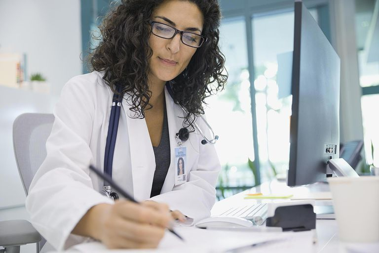 Female doctor writing notes