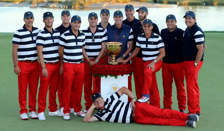 Team USA team members pose with the trophy following the 2017 Presidents Cup