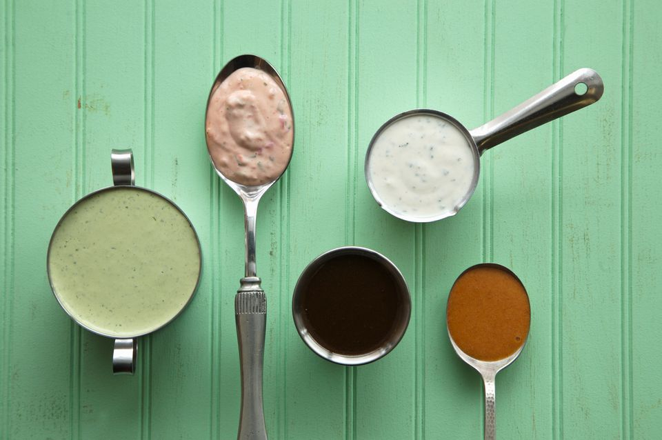 Variety of Homemade Dressings in Bowls and Spoons