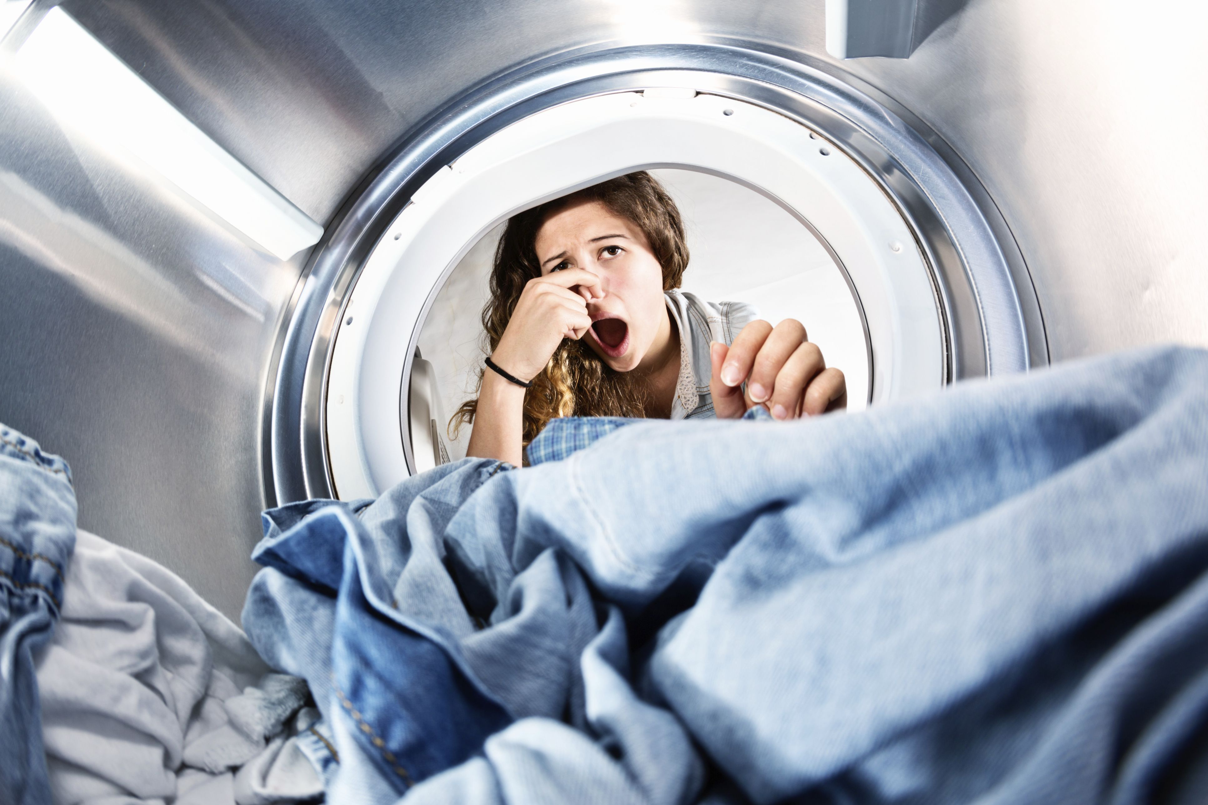 why does my front load washer smell so bad. Black Bedroom Furniture Sets. Home Design Ideas