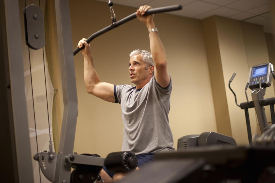 Man concentrates on his workout in a gym