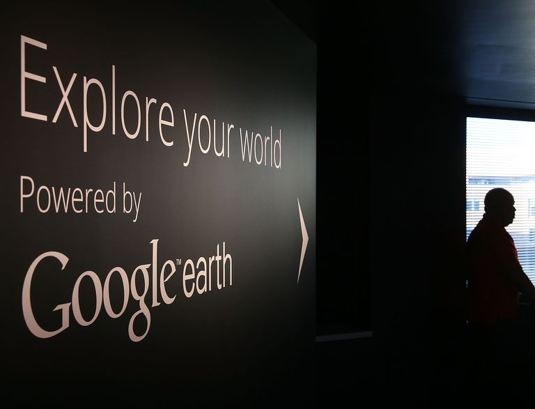 A man stands near a Google Earth exhibit at Google's Washington headquarters,