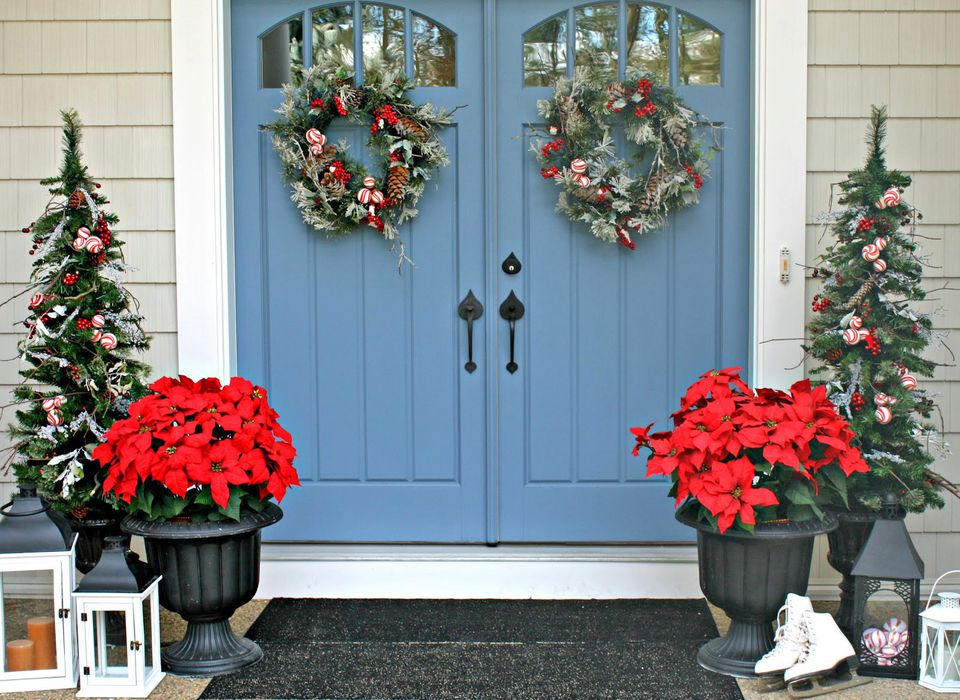 Blue doors christmas front porch with ponsettas